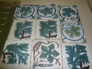 9 OLD ANTIQUE TILES,RAISED DESIGN.FIREPLACE PROBABLY.