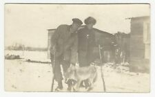 RPPC, Two men with guns and their wolf kill, ca1900s-1910s