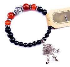 Red agate and onyx bracelet  w/ antiqued silver charm of safe travel & longevity
