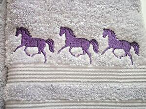 HORSE BORDER, EMBROIDERED DESIGN, ON A LAVENDER HAND TOWEL
