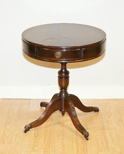 REGENCY STYLE MAHOGANY DRUM TABLE WITH TWO DRAWERS RAISED ON PAW FEET