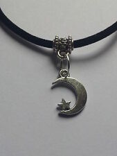 "MOON AND STAR  CHARM ON BLACK  3MM VELVET CORD  17"" INCHES NECKLACE."