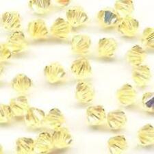 X 100 Cristalli SWAROVSKI ELEMENTS ORIGINALI 5301 BICONE Bicono 4mm Jonquil AB