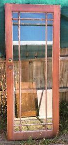 Wooden door with full glass panel