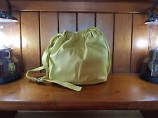 Zingy bright yellow French Connection drawstring leather handbag