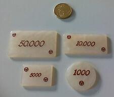 Lote de 4 fichas de casino de 1000, 5000, 10000 y 50000 pesetas. 4 casino chips.