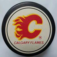 CALGARY FLAMES NHL GENERAL TIRE SLUG JOHN A. ZIEGLER GAME PUCK TRENCH MFG.