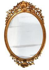 Grand miroir ovale Napoléon III en stuc doré XIXème
