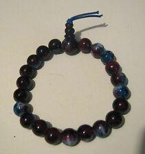 Very pretty multi-coloured marbled elasticated beaded bracelet