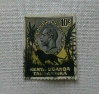 FRANCOBOLLO KENIA UGANDA TANGANYKA 10 cent GIORGIO V 1935 nero e giallo used