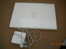 APPLE MACBOOK - early one - complete with power adaptor