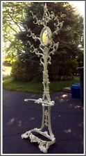 Antique cast iron tall hall tree stand very ornate with oval mirror late 1800's