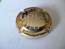 capsule de champagne, MIGNON Pierre, prestige Gold, lettres blanches, N°64a