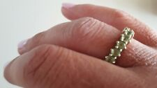 9ct gold peridot eternity ring. Size 9 , in excellent condition.
