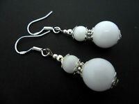A PAIR OF DANGLY WHITE JADE BEAD EARRINGS WITH 925 SOLID SILVER HOOKS. NEW..
