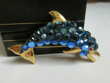 gold tone Dolphin brooch Signed Vintage Suzanne Bjontegard blue crystal on