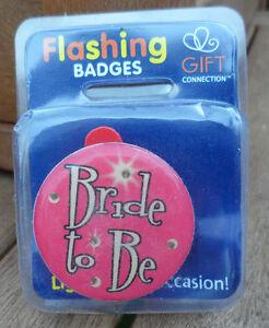 flashing pin badge/ fridge magnet new in original pack. bride to be pink.