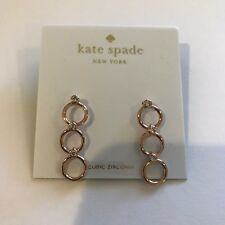 "Kate Spade New York, circle triple drop"" Earrings, Chain reaction rose gold tone"