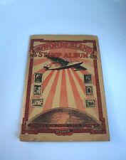 "VINTAGE 1935 ""THE WONDERLAND STAMP ABLUM"" BY HYGRADE: ALBUM WITH STAMPS"