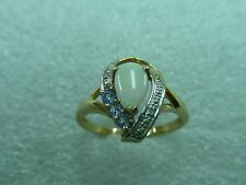 10K SOLID YELLOW GOLD OPEL,DIAMOND CHIPS and light blue Topaz RING. Jewelry Lot