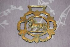 Antique Horse Brass with detailed surround and horse in the middle