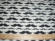 Cotton fabric black Moustaches of all sizes on tan  BTY