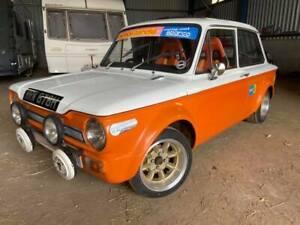 1970 Hillman Imp Rally car tribute . Cobra seats GRP arches minilite alloys .