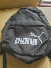 Boys medium sized Puma backpack in black New never used