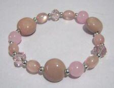 Lovely elasticated beaded bracelet various pastel pink tone beads