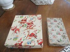 2 old cardboard Christmas boxes.