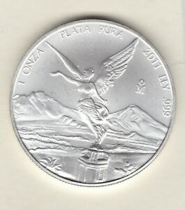 2011 MEXICO SILVER ONE OUNCE .999 LIBERTAD COIN PURA IN NEAR MINT CONDITION.