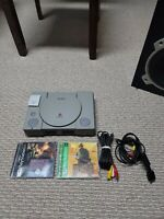 Sony PlayStation Console 1 (SCPH-7001) with 1 joystick 1 memory 2 games