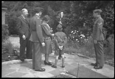 Small format negative - Young man having 'rifle drill' with 2 soldiers & family