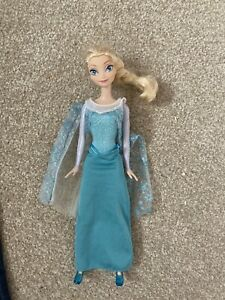 Elsa Doll Frozen blue dress comes with shoes good condition