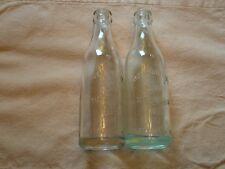 2 Clear Embossed Soda Bottles, Hub Bottling Works Marshfield Wis.