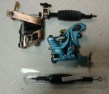 A pair of tattoo guns and case