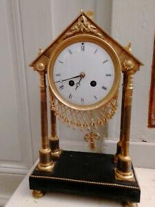 Pendule portique bronze doré époque  XIXéme