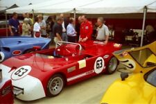 PHOTO  A BUSY PADDOCK OF PRE-72 GT CARS WITH BOBBY BELL'S ALFA ROMEO 33TT3 NESTL