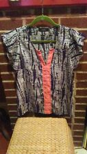 ZOUK SZ M BLK/WHT W/ORANGE STRIPE DOWN CENTER TOP
