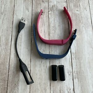 PREOWNED FIT BIT TORY BURCH BAND AND RED BAND 2 DRVICES WITH CHARGER