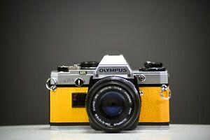 Olympus OM10 35mm Film Camera w/50mm f/1.8 Zuiko Lens Yellow Leather | Serviced