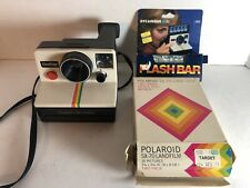 Vintage Polaroid SX-70 Land Camera With Used Flash Bar And Opened Two-Pack Film