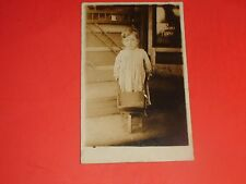 ZX561 Vintage RPPC Young Child Night Gown Toy Wheel Barrow Piano Store Sign