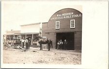 RPPC NE Cody W.M. Anderson Livery Stable Nebraska Wagons Horse Men Real Photo