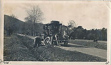 """1913 Man Changing Flat Tire, Old Car, """"Earned my Trip to Europe"""" Photograph"""