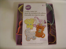 WILTON METAL 4pc BABY COOKIE CUTTER SET/ BUGGY,TEDDY BEAR,SHIRT /NEW/SEALED