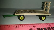 1/64 ertl farm toy green gear w/single yellow rims Plastic Moores flat hay rack