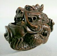 Antique 19th century Japanese boxwood Netsuke Seated dragon Signed onyx eye
