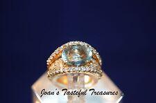 18k YG Ring with 2.7 ct Aquamarine Center Stone Bridged Over Diamonds