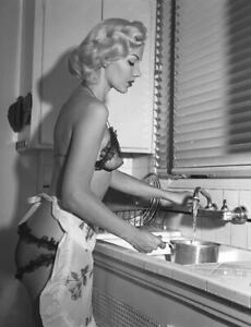 1960s Pinup in silk bra panties and apron at kitchen sink  8 x 10 Photograph